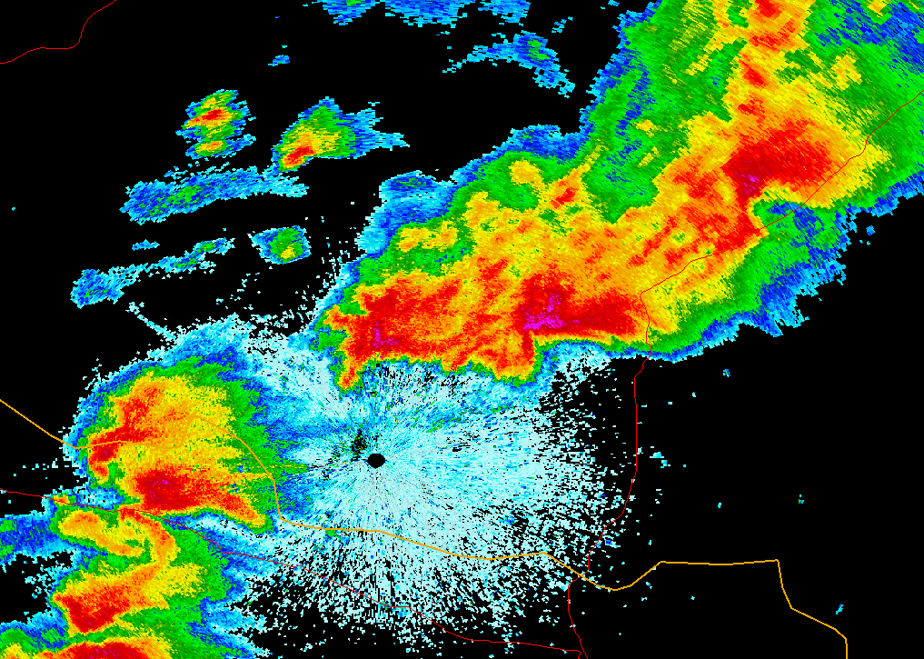 Radar reflectivity image of simultaneous tornadic and nontornadic supercell storms in Oklahoma, being analyzed by Dr. Matthew Van Den Broeke.